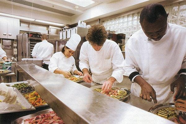 Chefs in a kitchen prepping